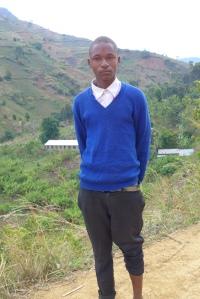 Erick bor i Maguruwe på den andre siden av åsen i bakgrunnen.